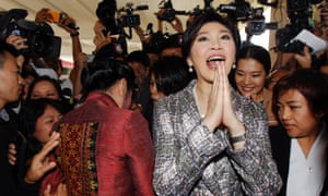 Yingluck Shinawatra pictured giving a traditional greeting at Thailand's parliament in January.