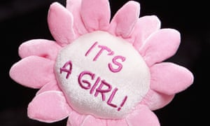 A pink stuffed toy flower with the logo 'It's a girl'