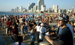Israelis on the beach in Tel Aviv