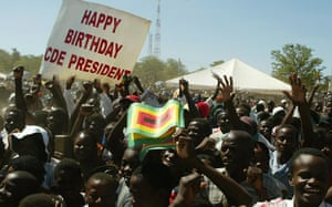 Supporters of Zimbabwe's president, Robert Mugabe, cheer at a huge 84th birthday rally in 2008.