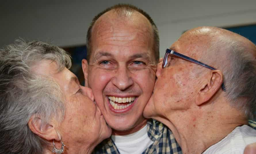 Al-Jazeera journalist Peter Greste, pictured with his parents, who won the judges's award, along with his colleagues Mohamed Fahmy and Baher Mohamed.