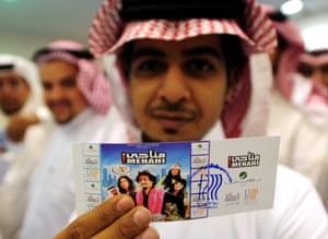 A Saudi man holds up his entrance ticket to see a film in Jeddah in 2008