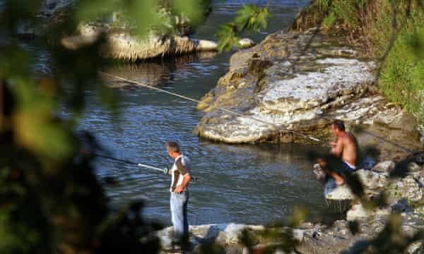 Fishermen cast their lines in Vjosa river, near the city of Permet, Albania