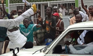 Burundians gather outside the headquarters of the popular independent African Public Radio (RPA) in Bujumbura on 18 February to welcome the release of Bob Rugurika.