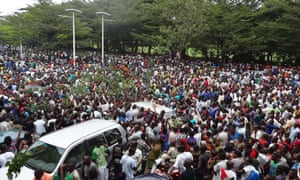 Burundians gather outside the headquarters of RPA in Bujumbura to welcome the release on bail of Rugurika.