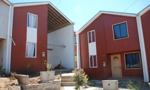 """Elementa's """"half"""" house, beside one that has been extended to double its size."""