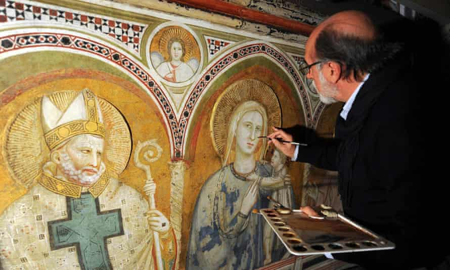 Italian restorer Sergio Fusetti looks at frescoes during an inspection of the vault of the Chapel of Saint Nicolas in the lower Basilica of San Francis in Assisi.