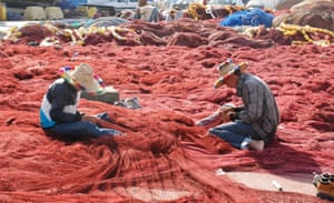 Moroccan fishermen restore their nets A groups of fishermen restore their nets in Tangier