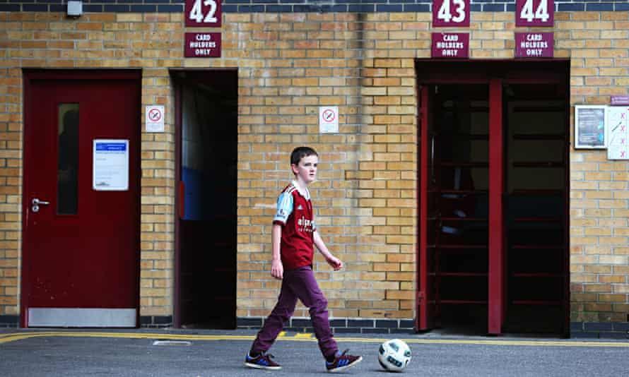 A young West Ham fan outside Upton Park stadium.