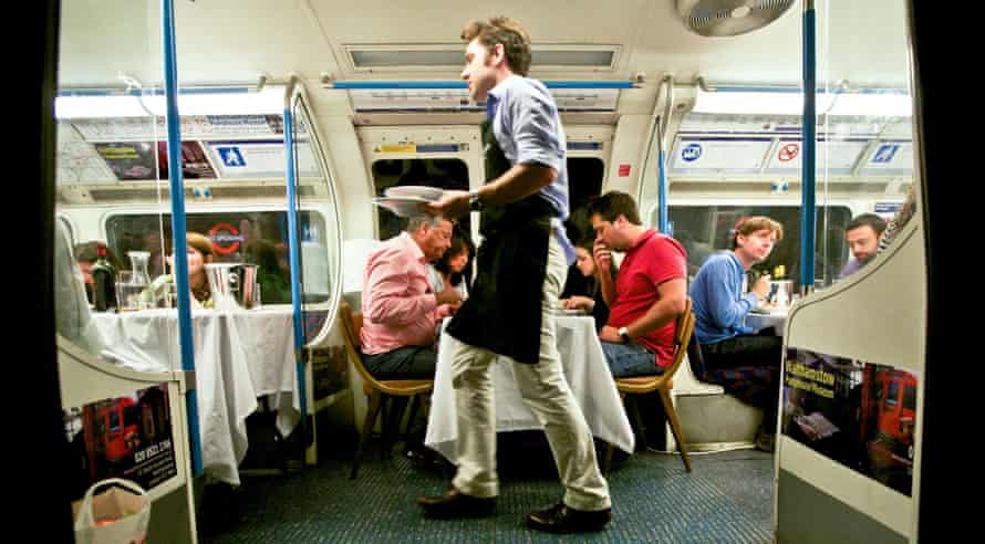 Dinner is served on the Underground Supper Club tube carriage.