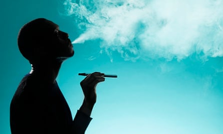 man smoking e cigarette