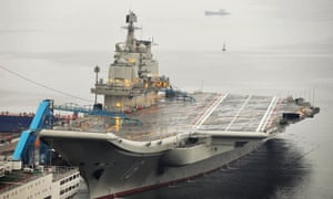 China's first aircraft carrier, which was renovated from an old aircraft carrier that China bought from Ukraine in 1998, is seen docked at Dalian Port, Liaoning province, in a 2012 photo.
