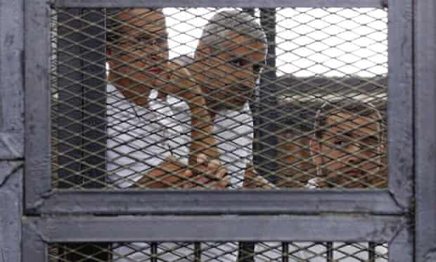 From left: Peter Greste, Mohammed Fahmy and Baher Mohamed during their trial in June 2014. Fahmy, as a Canadian, is also expected to be deported but Mohamed must hope for a presidential pardon or retrial.