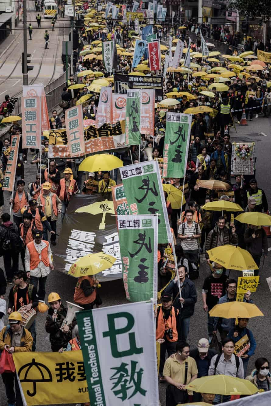 Demonstrators march for democracy in Hong Kong.