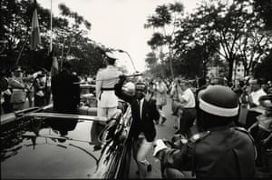 HUMAN RIGHTS HUMAN WRONGS  Leopoldville [Young man steals the sword of King Baudouin I, during procession with newly appointed President Kasavubu], Leopoldville, Republic of the Congo (now Democratic Republic of the Congo), June 30 1960, by Robert Lebeck