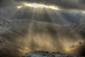 Sun breaks through the clouds over Martindale, Lake District