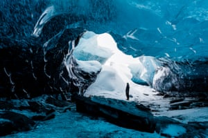 A man in the ice caves of Vatnajokull, Iceland