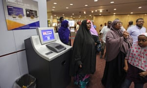Members of the Somali community wait in the lobby as leaders try to get the attention of a U.S. Bank manager to give a letter requesting a meeting about the bank's announced closure of money transfers accounts to Somalia, in St. Paul, Minnesota June 27, 2014. Somali money transfer businesses are finding it increasingly difficult to find banks to work through to transfer money electronically to family in Somalia because of the U.S. government's increased regulations and scrutiny of accounts, enacted to prevent the flow of money to militant organizations.