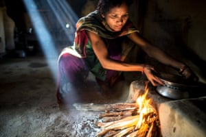 A woman prepares lunch at her home