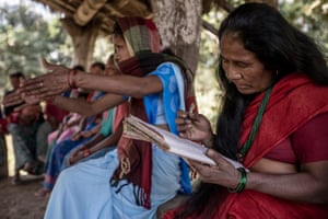 Women learn about organic agriculture at a meeting in the village