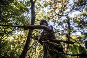 A woman collects firewood from the forest