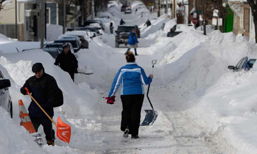 Residents in South Boston dig out their cars following the recent visit of snowstorm Juno.