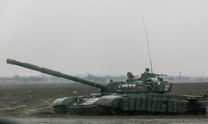 A pro-Russia separatist tank on a road in Yenakieve town, northeast from Donetsk, on Monday.