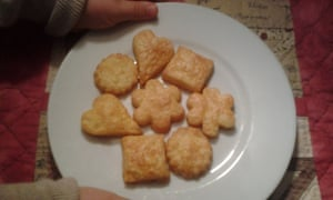 Rosemary's daughter Miranda with Aunt Edie's cheese biscuits, freshly baked.