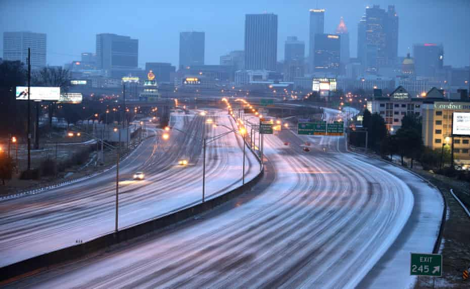 "Atlanta's I-75/I-85 freeway is bizarrely car-free following last February's forecasts of a snowstorm ""of historic proportions""."