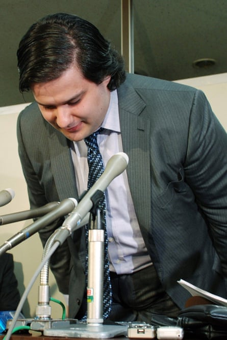 Mark Karpeles, president of MtGox bitcoin exchange bows his head during a press conference in Tokyo after the hack.