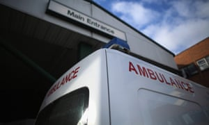 An ambulance outside a hospital A&E entrance