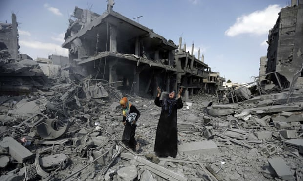 A Palestinian woman amid destroyed buildings in the Gaza Strip during a humanitarian truce in July 2014.