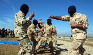 Government-backed Sunni Arab tribesmen from paramilitary groups train to fight Islamic State (Isis) militants in northeast of Mosul, northern Iraq.
