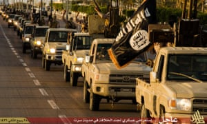An Islamic State propaganda image made available by Islamist media outlet Welayat Tarablos on February 18, 2015, allegedly shows members of the Islamic State (IS) militant group parading in a street in Libya's coastal city of Sirte, which lies 500 kilometres (310 miles) east of the capital, Tripoli. Egyptian F-16s bombed militant bases in the eastern Libyan city of Derna in mid-February after the Islamic State group in Libya released a gruesome video showing the beheadings of a group of Egyptian Coptic Christians who had gone to the North African country seeking work.
