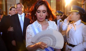Fernandez walks in front of her husband, outgoing President Nestor Kirchner after her inauguration ceremony.