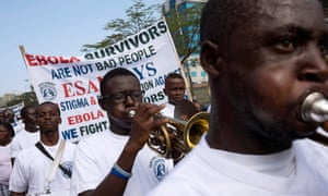 The blood of Ebola survivors like these, marching in a Valentine's Day parade in Monrovia, could help others fight the disease.