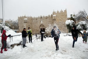 Jerusalem, Israel Palestinian children play in the snow near Damascus Gate in Old City as snow falls. People in Jerusalem woke up to around 25 centimetres of snow after the second major blizzard of winter swept across the hilltop Holy City