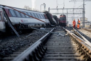 Rafz, Switzerland Rescue service men and firemen work at a derailed train a the accident site. The collision of two passenger trains in the early morning caused five injured, one of them severe, police said