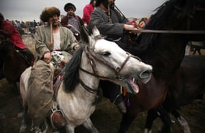 Kabul, Afghanistan Afghan horsemen compete during a game of Buzkashi. Buzkashi is an Afghan national sport which is played between two teams of horsemen, competing to throw a goat carcass into a scoring circle.