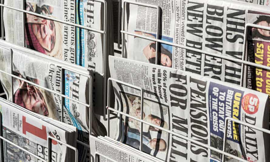 National newspapers on a news stand