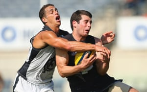 Melbourne, Australia Blaine Johnson of the Blues is tackled by Ed Curnow during the Carlton Blues AFL Intra-Club match at Ikon Park