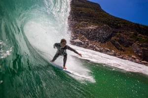 Cape Town, South Africa South African surfer Stuart Bradburn rides a wave on the south peninsula. The prevailing offshore South East wind during the summer months on the South African West Coast causes a grooming effect on waves breaking at surf spots resulting in perfectly formed and hollow waves for surfers to ride