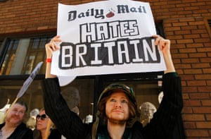 A demonstrator outside the Daily Mail offices responds to its attack on Ralph Miliband