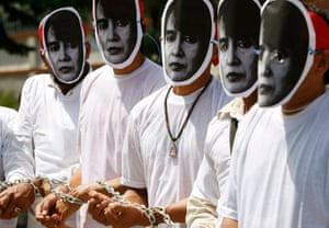 Activists wearing masks of Myanmar's opposition leader Aung San Suu Kyi