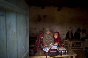 Islamabad, Pakistan Afghan refugee schoolgirls attend a class at a makeshift school