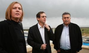 Former justice minister and Hatnuah party leader Tzipi Livni, Labour party leader Isaac Herzog and former defence minister Amir Peretz look out over the Gaza Strip from the Israeli border.