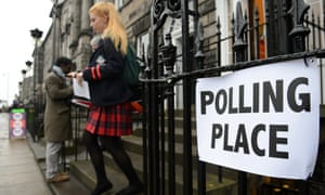 A young woman outside a polling station.
