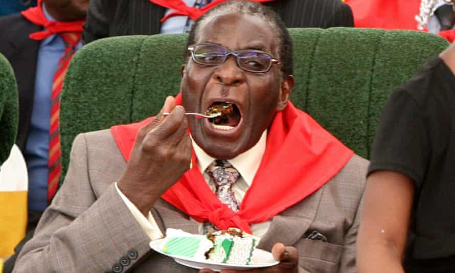 Robert Mugabe eating cake