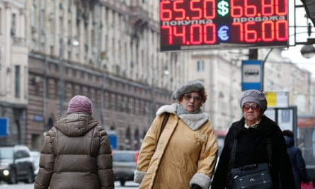 A board displays currency exchange rates in Moscow on 11 February.