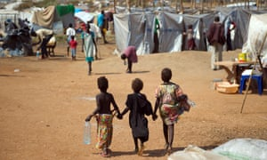 Children walk through a camp for internally displaced persons in Juba, South Sudan